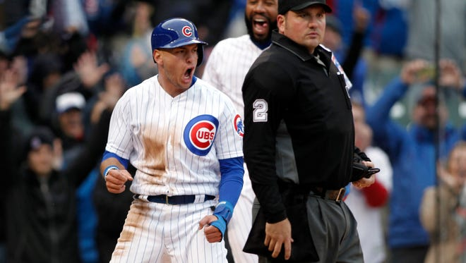 Cubs center fielder Albert Almora Jr. celebrates after scoring the winning run.