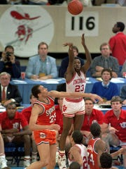 Indiana's Keith Smart (23) fires a shot past Syracuse's Howard Triche for a basket putting Indiana ahead by one point in the final seconds of the 1987 NCAA championship game.
