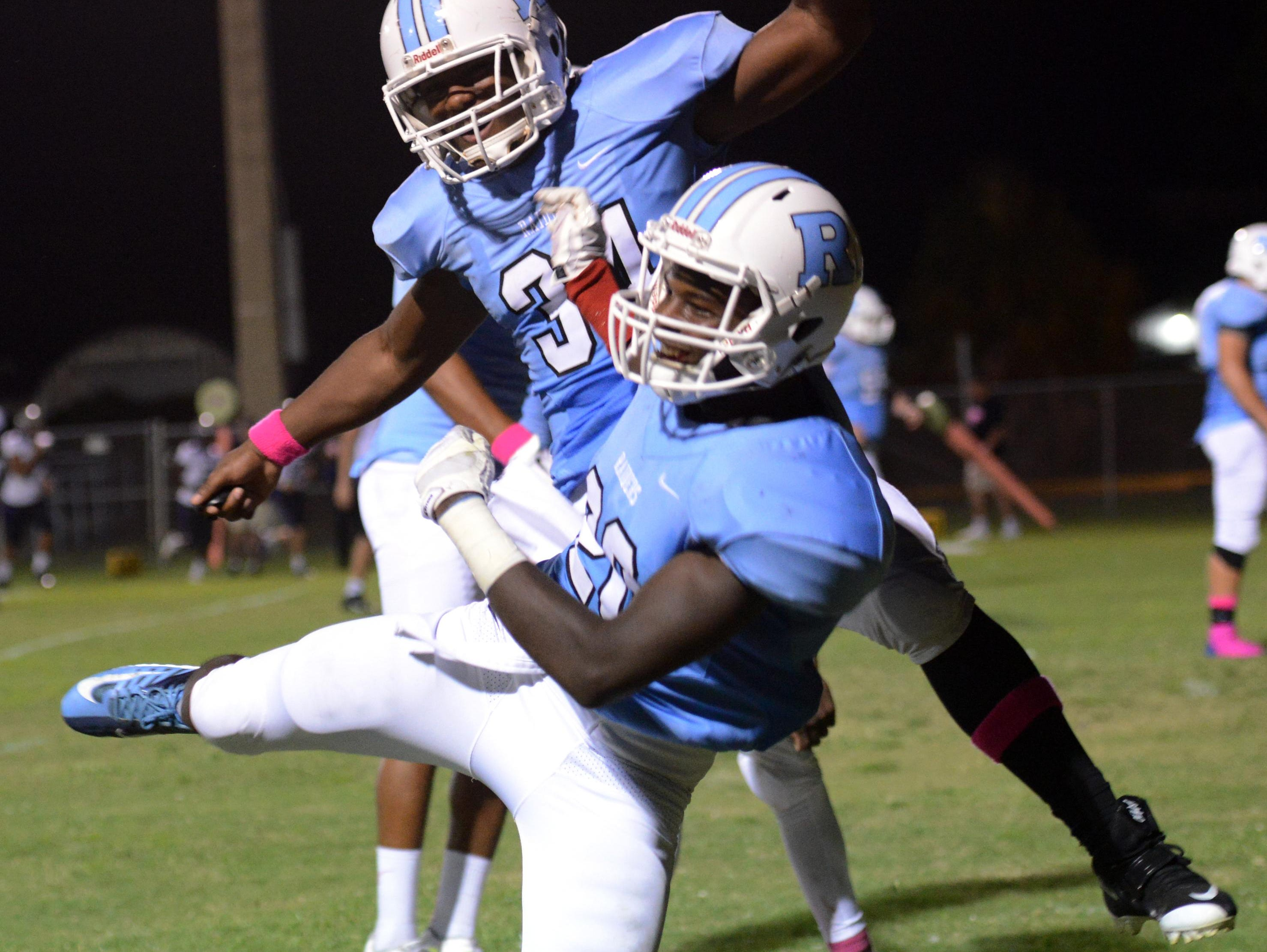 Tray Lovett of Rockledge celebrates his touchdown with teammate Orlando Oquendo during a recent game at McLarty Stadium.