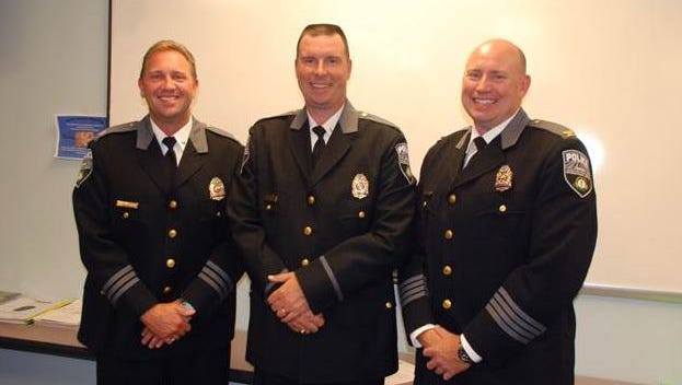 From left-to-right: Incoming Police Chief Scott Schwartz, incoming Assistant Police Chief Shawn Ward and retiring Police Chief Kevin Murphy
