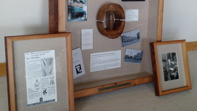 Tom Van Lieshout presented an advertisement from his family's clothing shop (left), a shadowbox with a hat spreader and information about the shop (center) and a photo of his grandfather (right).