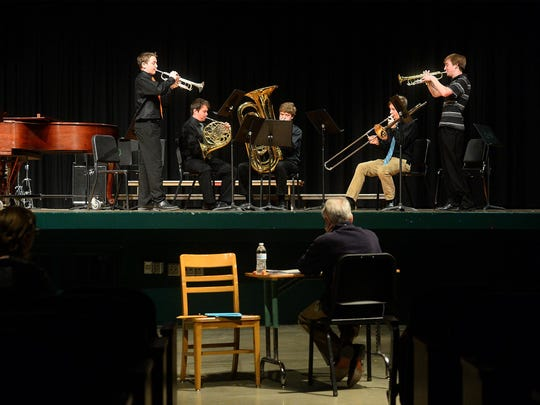 CMR's Corno Cornetts and the Sagbuts group play for adjuticator Lance Boyd at the MHSA District 6 Music Festival on Friday at CMR.