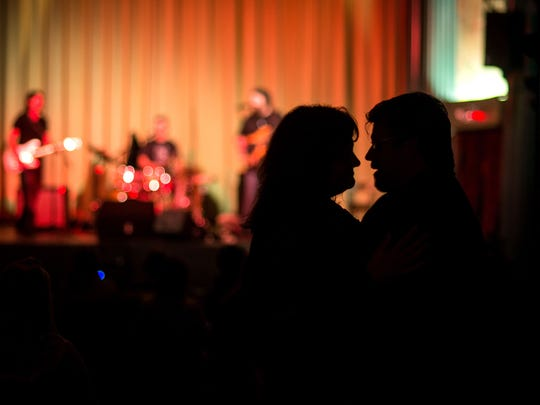 A couple dances to the music of Lower Case Blues as they perform on the Milton Theatre stage Saturday night.