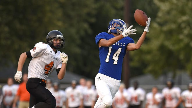 Sartell's Brandan Walz pulls in a pass over St. Cloud Tech's Andrew Setrum and takes it in to score early in the first quarter Friday at Sartell.