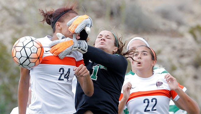 UTEP midfielder Aleah Davis gets smacked in the face by Marshall goal keeper Lizzie Kish on a corner kick during their match Sunday at University Field.