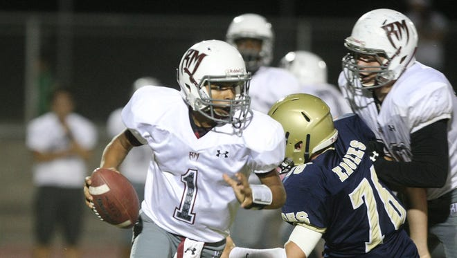 Rancho Mirage QB Marques Prior turns the corner on a scramble during a prep football game between Rancho Mirage and Desert Hot Springs high schools at Desert Hot Springs Thursday , October 9 2014.