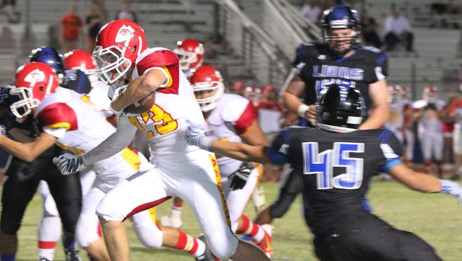 Palm Desert's Beau Berryhill runs the ball during the first half of the game in Cathedral City on Friday, October 16, 2015.