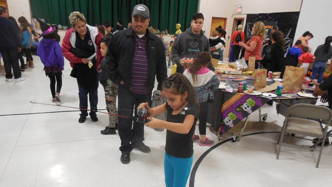 Children and their families enjoyed a carnival-like atmosphere during the Fall Festival sponsored and hosted by students at Deming Cesar Chavez Charter High School.