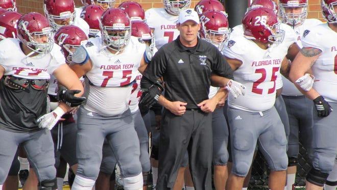 Florida Tech football coach Steve Englehart gets ready to run onto the field with his team.