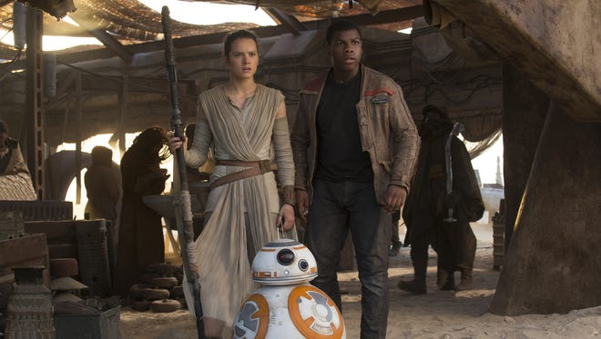 Rey (Daisy Ridley) and Finn (John Boyega) in 'The Force Awakens.'