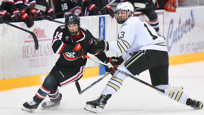 St. Cloud State's Patrick Newell, left, tries to breakaway form Western Michigan's Neal Goff while chasing the puck Jan. 22, 2016 at the Herb Brooks National Hockey Center. Newell has 17 points and is a plus-19 in 24 games for the Huskies this season.