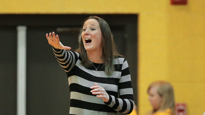FILE -- Marian head coach Katie Gearlds shouts out a play during the Crossroads League Tournament Championship against Huntington held at the Physical Education Center at Marian University on Monday, Mar. 2, 2015.