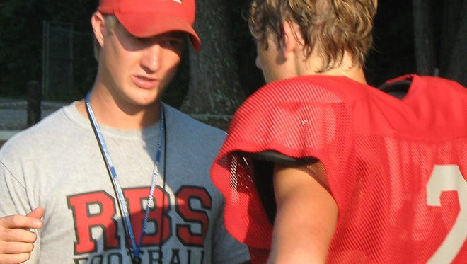Red Boiling Springs football coach Kyle Shoulders, left, has resigned to be an assistant at Oakland.