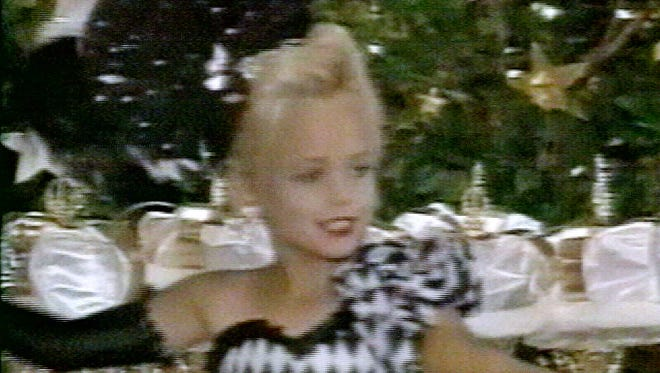 This file image made from an undated family video shows JonBenet Ramsey performing during a beauty pageant. Citing new DNA tests, prosecutors in 2008 cleared JonBenet Ramsey's parents and brother in the 1996 killing of the 6-year-old beauty queen and apologized to the family for casting the cloud of suspicion that hung over them for more than a decade.