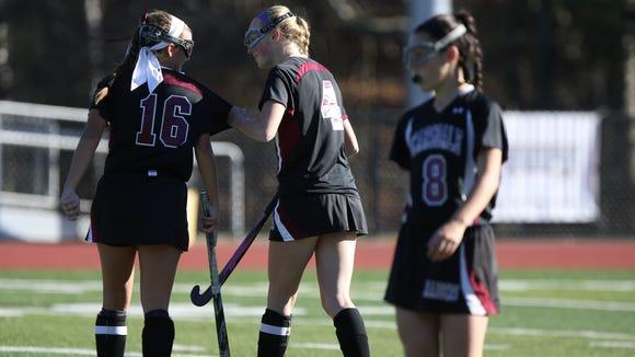 Scarsdale's Emma Coleman (4) grabs teammate Erin Nicholas