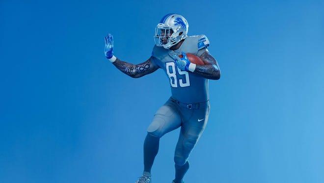 Eric Ebron models the Detroit Lions' new Color Rush grey uniform.