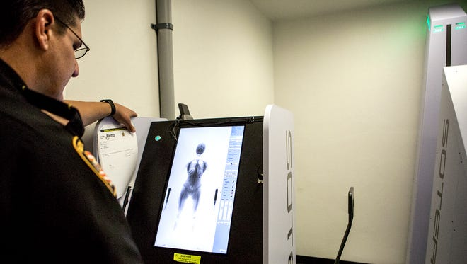 Captain Chris Barbuto shows the Advocate sample body scans used for training officers on the Licking County Jail's new body scanner used to find contraband before inmates are admitted.
