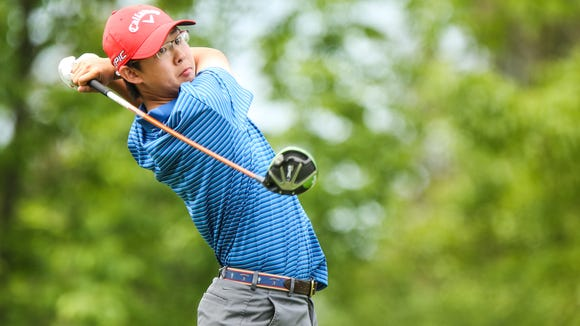 Section 1's Nathan Han tees off on the 10th tee during the playoff round of Round 2 of the NYSPHSAA Boys Golf Championships at Robert Trent Jones Golf Course in Ithaca. Han won the event.