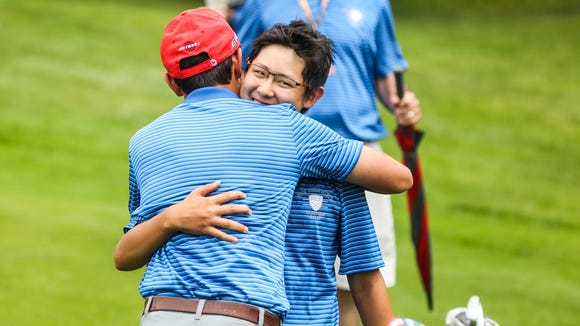 Section I's Nathan Han celebrated his win with teammate Alex Kyriacou after winning the NYSPHSAA Boys Golf Championship Boys Golf Championships at Robert Trent Jones Golf Course in Ithaca.