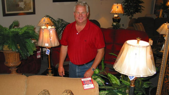 Geiman Furniture Gallery owner Tim Geiman inside the store's showroom where he routinely works greeting customers and making sales.
