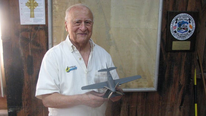 Vinney Paxhia's very first carving was that of a model Curtis Wright P40Q, a fighter plane that flew in World War II.