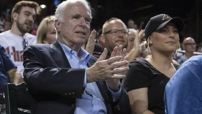 Sen. John McCain and his daughter Meghan McCain attend the Arizona Diamondbacks and Los Angeles Dodgers game on Aug. 10, 2017, at Chase Field in Phoenix.