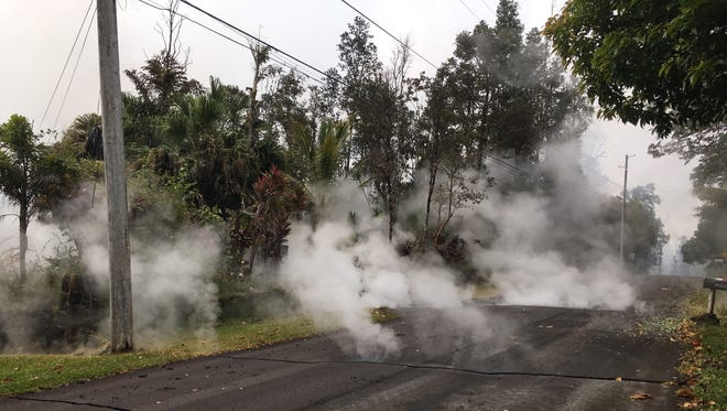 Steam rises from a fissure in the Leilani Estates subdivision near Pahoa, Hawaii, on May 7, 2018.