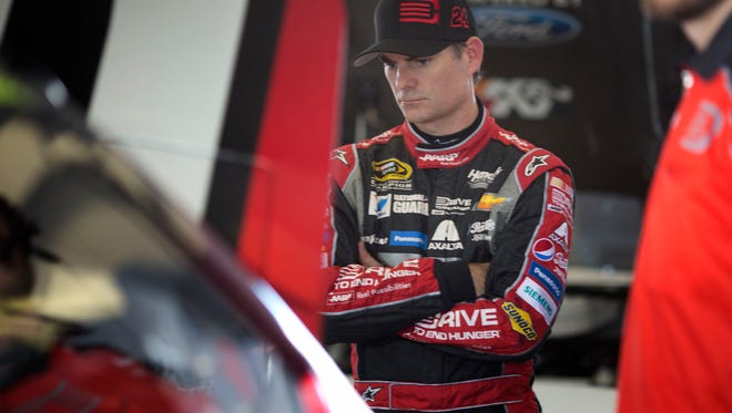 NASCAR driver Jeff Gordon waits in his garage as he prepares for a Sprint Cup Series Ford EcoBoost 400 auto race practice session, Friday, Nov. 14, 2014, in Homestead, Fla. (AP Photo/J Pat Carter)
