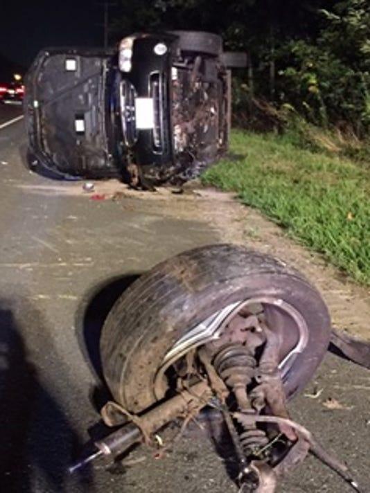 Manchester-overturned-car