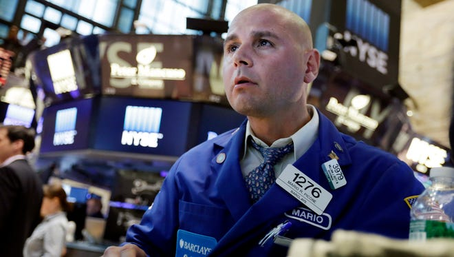 Specialist Mario Picone works on the floor of the New York Stock Exchange on Monday. U.S. stocks closed sharply lower, with the Dow Jones industrial average down more than 588 points and the Standard & Poor's 500 index now down more than 10 percent off its recent high.