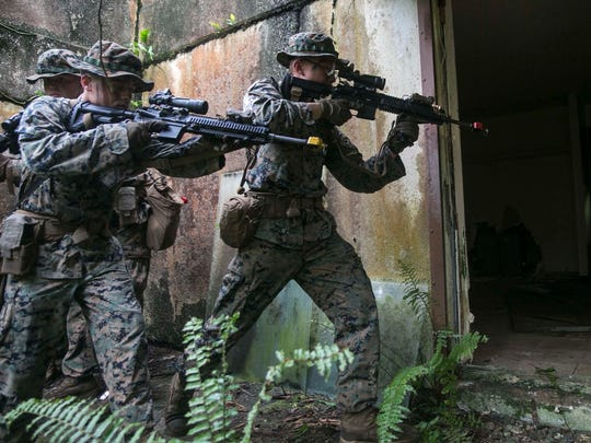 In this Aug. 3o, 2017, file photo, Marines clear an abandoned house during urban training at Andersen South Air Force Base. The military gave Congress a list of unawarded military construction projects that could be cut to pay for a border wall, including some Guam buildup projects.