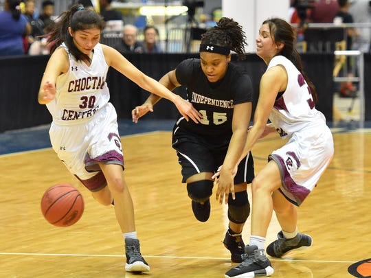 Independence's Davion Watt (15) tries to break the press of Kyannah Grant (30) and Kyarrah Grant of Choctaw Central during the MHSAA Girls 3A Championship Game held at The Coliseum in Jackson MS.(Photo/Bob Smith)