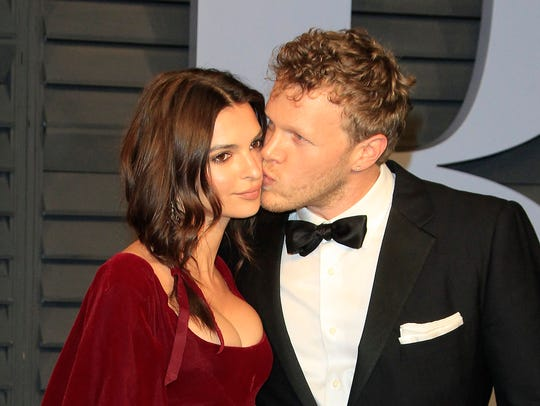 "Newlyweds Emily Ratajkowski and Sebastian Bear-McClard pose at the ""Vanity Fair"" Oscar after-party in March."