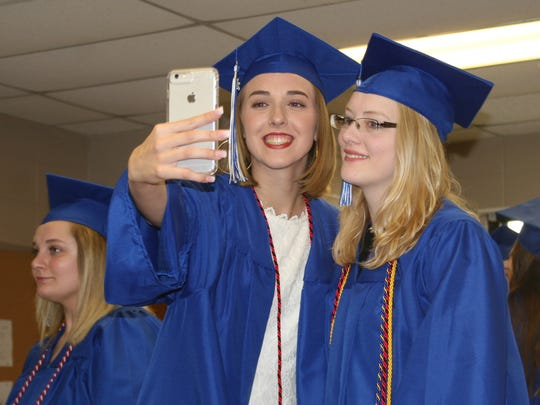 Two 2018 Cotter graduates pose for a selfie before last year's graduation ceremony.