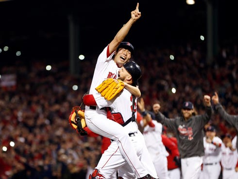 Koji Uehara reacts with catcher David Ross after defeating the Cardinals in Game 6.