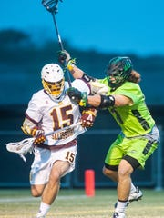 Salisbury attack Kyle Goss (15) absorbs a check from