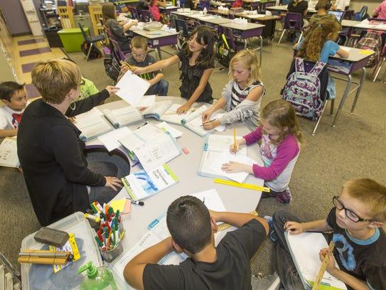 Some hope to use Arizona's additional revenue on education.