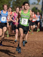 Grant Fisher wins the boys race in 15:03 in the 36th Foot Locker cross country championships at Morley Field at Balboa Park in San Diego, CA on Dec. 13, 2014.
