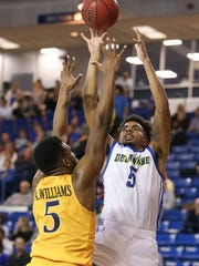 Delaware forward Eric Carter lifts a shot over Drexel's