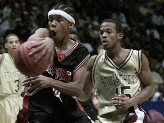 Neptune's Jerome Hubbard passes in frnt of St. Anthony's