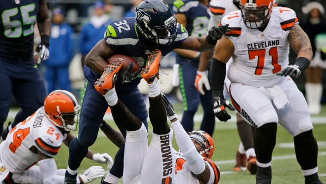 Seattle Seahawks' Christine Michael (32) carries against the Cleveland Browns during an NFL football game in Seattle. Michael rushed for a career-high 84 yards on just 16 carries in Seattle's win over Cleveland. It was the kind of performance Seattle waited to see from Michael since he was a second-round pick by the team in 2013.