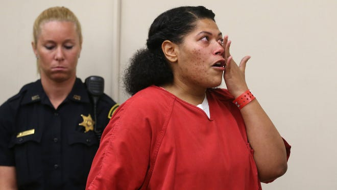 Rochester City Court Judge Leticia Astacio wipes away tears as she addresses the court during her sentencing for violating the terms of her 2016 drunk driving conviction Thursday, July 6, 2017.