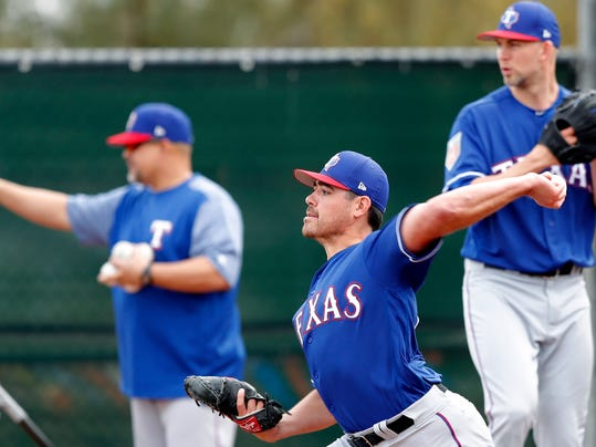 FILE - In this Feb. 15, 2018, file photo, Texas Rangers pitcher Matt Moore throws during a baseball spring training workout, in Surprise, Ariz. Moore hopes for a revival with the Rangers after tying for the most losses in the NL last season in San Francisco. (AP Photo/Charlie Neibergall, File)