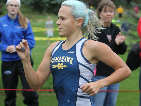 Tomahawk's Dani Whiting cruises to victory in the D2/3 girls varsity race at the Smiley Invitational in Wausau, Saturday, September 20, 2014.