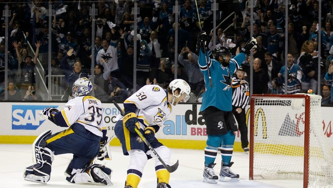 San Jose Sharks' Joel Ward, right, celebrates after scoring past Nashville Predators goalie Pekka Rinne (35) and Roman Josi (59) during the first period in Game 7 of the Western Conference finals on May 12, 2016.
