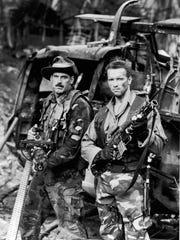 Tough guys Jesse Ventura and Arnold Schwarzenegger