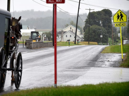 Amish buggies pass by the New Hope Amish School Wednesday, Sept. 28, 2016. The school was built several hundred yards from the former West Nickel Mines School. New Hope replaced the old one-room Amish schoolhouse where 11 girls were shot - six were injured and five were killed - on Oct. 2, 2006.