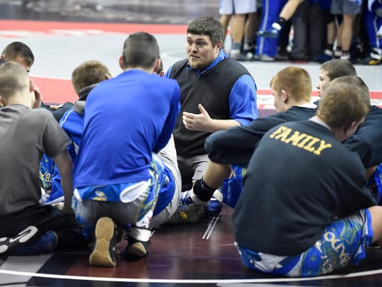 Northern Lebanon coach Rusty Wallace talks to his wrestlers minutes before the state championship meet at the Giant Center on Feb 12.