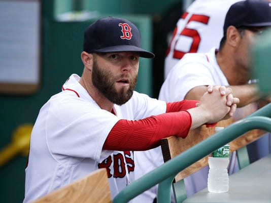 Boston Red Sox second baseman Dustin Pedroia sits in the dugout prior a baseball game against the Cleveland Indians at Fenway Park, Tuesday, Aug. 1, 2017, in Boston. The Red Sox placed Pedroia on the 10-day disabled list due to a left knee injury prior to the game. (AP Photo/Charles Krupa)
