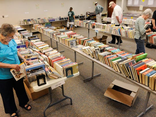 Joann Hoffman of Manitowoc, left, shops for books at Manitowoc Public Library's used book sale. More than 1,000 books are for sale from 9 a.m. to 3 p.m. today in the Balkansky Community Room as part of the Krazy Daze festivities.